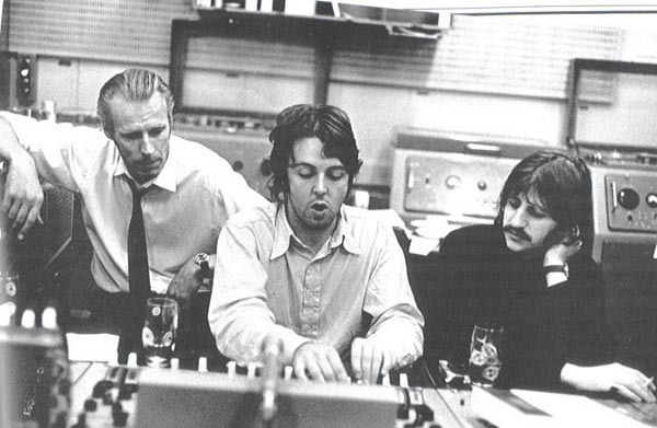 Paul McCartney in studio with George Martin